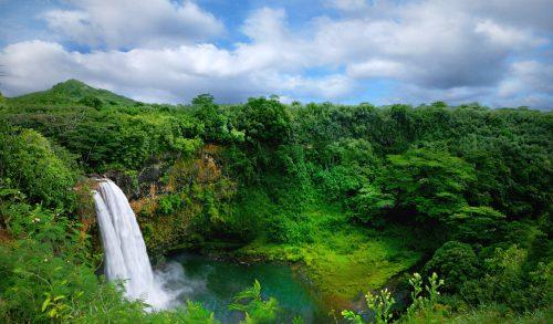 Lush Green Landscape Waterfall on the Hawaiian Islands With Beautiful Sky