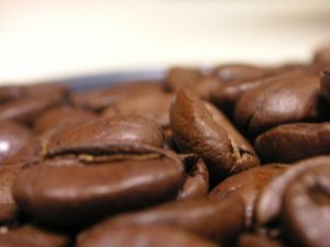 """Kona Coffee Bean Closeup 1"" by mikepetrucci is licensed under CC BY-SA"